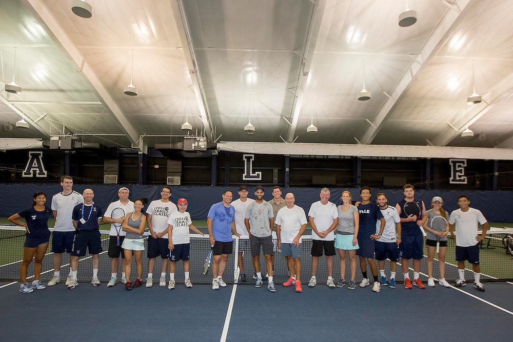 August 21, 2014, New Haven, CT:<br /> Andy Roddick and James Blake pose with participants for a group photo during a pro-am session during the Men's Legends Event on day seven of the 2014 Connecticut Open at the Yale University Tennis Center in New Haven, Connecticut Thursday, August 21, 2014.<br /> (Photo by Billie Weiss/Connecticut Open)