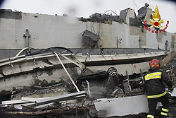 A major motorway bridge has collapsed near the Italian City of Genoa. The bridge known as Ponte Morandi is part of the A10 Motorway connecting the city of Genoa to Savona and Ventimiglia collapsed this morning.<br /><br /><br />This photo is usable in respect of the context in which has been taken, and without the defamatory intent of the decoration of the persons represented.
