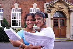 Twin Sisters (left to right) Reena and  Sheena Sodha from Chelmsford County High School for Girls, both got 3 A's from their A-Level results. August 18, 2000. Photo by Andrew Parsons/i-Images..