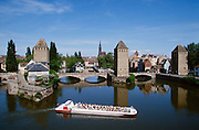 """View from Barrage Vauban towards the """"Petite France"""" (the old town), a bâteau-mouche (tourist boat) and the cathedral."""