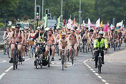 © Licensed to London News Pictures. 12/06/2016. Brighton, UK. Naked demonstrators take part in the yearly Naked Bike Ride in Brighton to protest against car culture and raise awareness of cyclists on the road. Photo credit: Hugo Michiels/LNP