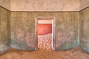 Near Lüderitz, lies Kolmanskop (or Kolmanskuppe), an abandoned diamond mining town from the early 1900's.  Abandoned in 1956, it has been invaded by the sand of the Namib Desert and is now a ghost town.