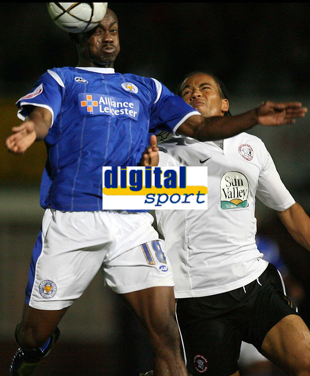 Photo: Rich Eaton.<br /> <br /> Hereford United v Leicester City. Carling Cup. 19/09/2006. Leicesters goalscorer Elvis Hammond left heads the ball watched by Tamika Mkandawire of Hereford