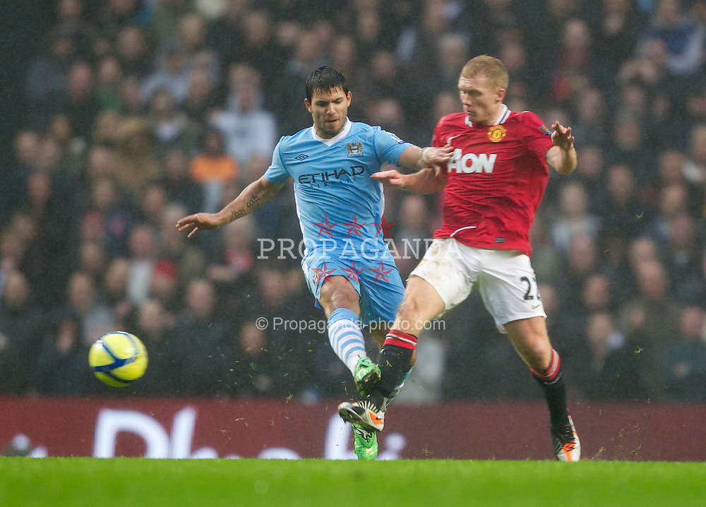 MANCHESTER, ENGLAND - Sunday, January 8, 2012: Manchester City's Sergio Aguero in action against Manchester United's Paul Scholes during the FA Cup 3rd Round match at the City of Manchester Stadium. (Pic by Vegard Grott/Propaganda)