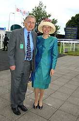 PETER BOTTOMLEY and is wife BARONESS BOTTOMLEY at Ladies Day at Epsom Racecourse, Surrey during the Derby Festival on 3rd June 2005.<br />