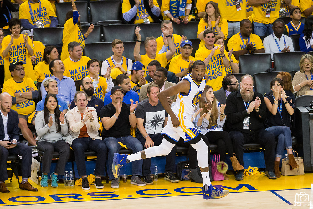 Fans cheer for Golden State Warriors forward Kevin Durant (35) after he makes a jumper against the Utah Jazz during Game 2 of the Western Conference Semifinals at Oracle Arena in Oakland, Calif., on May 4, 2017. (Stan Olszewski/Special to S.F. Examiner)