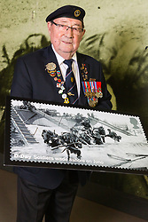 D-Day veterans Leading Stoker, Royal Navy, Fred Lee, 93, poses with an enlarged Royal Mail D-Day commemorative stamp at the National Army Museum in Chelsea, London. The stamps will be released on 2nd June.. London, May 22 2019.