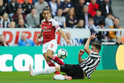 Paul Dummett (#3) of Newcastle United slides into to block the cross attempt from Hector Bellerin (#2) of Arsenal during the Premier League match between Newcastle United and Arsenal at St. James's Park, Newcastle, England on 15 September 2018.