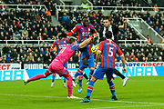 Andy Carroll (#7) of Newcastle United challenges for the ball from a cross as Vicente Guaita (#31) of Crystal Palace attempts to punch clear during the Premier League match between Newcastle United and Crystal Palace at St. James's Park, Newcastle, England on 21 December 2019.