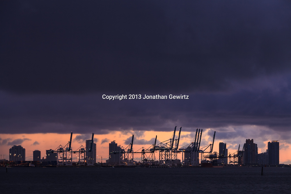 The port of Miami, Florida with Miami Beach condo buildings in the background, shortly before sunrise. WATERMARKS WILL NOT APPEAR ON PRINTS OR LICENSED IMAGES.