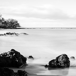 Mōkapu Beach black and white panorama photo in Wailea Makena Maui Hawaii with lava rocks and the Pacific Ocean. Panoramic photo ratio is 1:3. Copyright ⓒ 2019 Paul Velgos with All Rights Reserved.