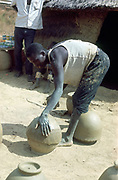 Making pots without a wheel. Nigeria c1966. Portrait format