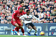 Fulham midfielder Ryan Sessegnon (3) takes on Liverpool defender Trent Alexander-Arnold (66) and Liverpool midfielder Georginio Wijnaldum (5) during the Premier League match between Liverpool and Fulham at Anfield, Liverpool, England on 11 November 2018.