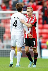 Sebastian Larsson of Sunderland greets Ki Sung-Yueng of Swansea City after the game ends 1-1 - Photo mandatory by-line: Rogan Thomson/JMP - 07966 386802 - 27/08/2014 - SPORT - FOOTBALL - Sunderland, England - Stadium of Light - Sunderland v Swansea City - Barclays Premier League.