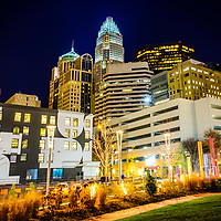 Charlotte NC downtown city at night photo with Romare Bearden Park. Charlotte, North Carolina is a major city in the Eastern United States of America. Includes Bank of America Corporate Center, Bank of America Plaza, and 121 West Trade buildings.