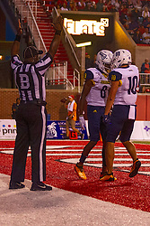 NORMAL, IL - September 21: Cleophas Miller signals touchdown next to the celebration by Stacy Chukwumezie and Hendrix Johnson during a college football game between the ISU (Illinois State University) Redbirds and the Northern Arizona University (NAU) Lumberjacks on September 21 2019 at Hancock Stadium in Normal, IL. (Photo by Alan Look)