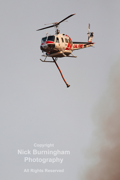 GLENDORA, CALIFORNIA, USA - JANUARY 16, 2014: A large wildfire burns out of control in the hills above Glendora. Firefighters, helicopters and aircraft from many jurisdictions work to control the blaze.