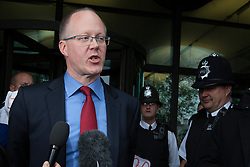 © licensed to London News Pictures. London, UK 23/10/2012. BBC director general George Entwistle talking to the media whilst leaving Portcullis House after giving evidence to Commons Culture Committee on BBC's response to Jimmy Savile affair. Photo credit: Tolga Akmen/LNP