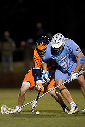 North Carolina Tar Heels Jack Ryan (32) battles for a loose ball against UVA.  The Virginia Cavaliers Men's Lacrosse Team defeated the North Carolina Tar Heels 10-9 in overtime at Klockner Stadium in Charlottesville, VA on April 7, 2007.