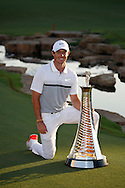 Rory McIlroy celebrates winning The Race To Dubai Tournaments with the trophy on the 4th day