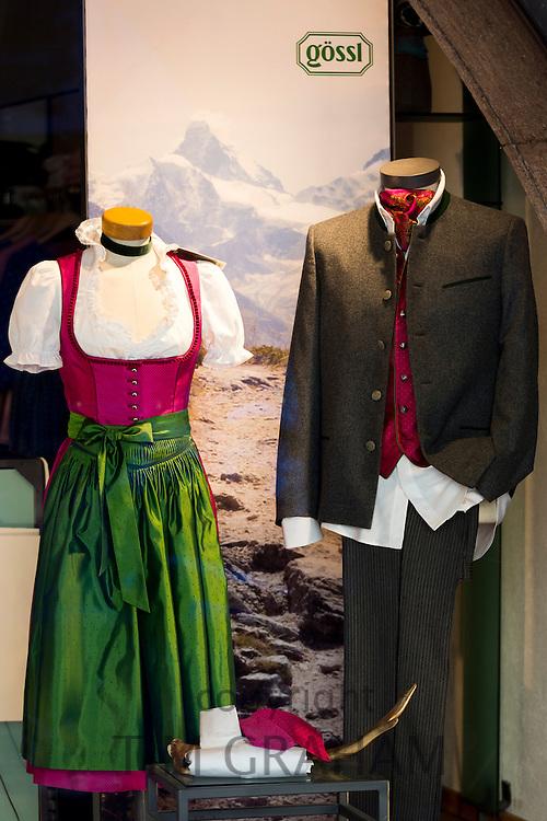 Traditional Tyrolean suit and dirndl dress in shop window in Herzog Friedrich Strasse in Innsbruck in the Tyrol, Austria