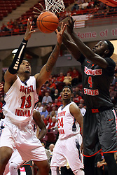 """08 November 2015: Terrence Tisdell(13) and Daouda """"David"""" Ndiaye (4) both grab for a rebound. Illinois State Redbirds host the Southern Indiana Screaming Eagles and beat them 88-81 in an exhibition game at Redbird Arena in Normal Illinois (Photo by Alan Look)"""