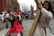 Actors Juan Ponce, 27 (R) and Jesus Ibarro, 21, portray Jesus Christ and his persecutors respectively during a Good Friday Via Crucis at St. Jerome Catholic Church in Chicago's Rogers Park neighborhood. The religious portrayal recounts the biblical steps of Jesus Christ being condemned to death, followed by his crucifixion and entombment.