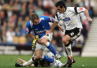 Photo: Rich Eaton.<br /> <br /> Derby County v Birmingham City. Coca Cola Championship. 21/10/2006. Gary McSheffrey left of Birmingham City srtuggles to get past Marc Edsworthy right of Derby County