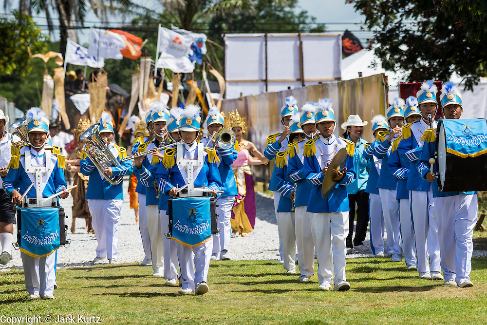 "28 AUGUST 2013 - HUA HIN, PRACHUAP KHIRI KHAN, THAILAND:  A high school marching band opens the  King's Cup Elephant Polo Tournament in Hua Hin, Thailand. The tournament's primary sponsor in Anantara Resorts and the tournament is hosted by Anantara Hua Hin. This is the 12th year for the King's Cup Elephant Polo Tournament. The sport of elephant polo started in Nepal in 1982. Proceeds from the King's Cup tournament goes to help rehabilitate elephants rescued from abuse. Each team has three players and three elephants. Matches take place on a pitch (field) 80 meters by 48 meters using standard polo balls. The game is divided into two 7 minute ""chukkas"" or halves. There are 16 teams in this year's tournament, including one team of transgendered ""ladyboys.""    PHOTO BY JACK KURTZ"