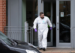 © Licensed to London News Pictures. 15/03/2019.Birmingham, UK. The scene in Wheeleys Lane, Lee Bank, Birmingham, where police have shot dead a man. Pictured, Forensic officer at the scene. Photo credit: Dave Warren/LNP