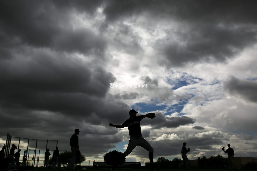 Seattle Mariners pitchers warm up during Spring Training on a cloudy day in Peoria, Arizona Monday February 23, 2015. (Bettina Hansen / The Seattle Times)