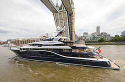© Licensed to London News Pictures. 09/06/2019. London, UK.  The luxury 279 feet long (85 metre) superyacht Solandge arrives in London on the River Thames under Tower Bridge this evening and is the first superyacht to visit the pool of London in the capital this year.  Superyacht Solandge is believed to have originally been built for the Russian billionaire Alexander Girda in 2013, superyacht Solandge is now rumoured to be owned by a Saudi Royal after being sold in 2017 for a reported EUR155m in the biggest yacht brokerage deal of 2017. Solandge is available for charter with rates starting from over EUR1m plus expenses per week and has numerous luxuries onboard including an outdoor cinema and nightclub with DJ deck, indoor and outdoor gyms, dive centre, tender garage, sauna, swimming pool, bar with Bechstein piano and has accommodation for 16 guests in eight elegant staterooms..  Photo credit: Vickie Flores/LNP