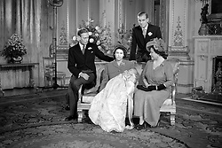 File photo dated 15/12/48 of Prince Charles sleeping in the arms of Princess Elizabeth, after his Christening at Buckingham Palace, with King George VI (left), the Duke of Edinburgh, and Queen Elizabeth. The Queen and Prince Philip will celebrate their platinum wedding anniversary on November 20.