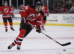 Oct 8; Newark, NJ, USA; New Jersey Devils left wing Patrick Elias (26) skates with the puck during the first period of their game against the Dallas Stars at the Prudential Center.