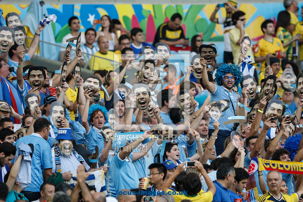 Uruguay fans with Luis Suarez masks during the 2014 FIFA World Cup last 16 match at Maracana Stadium, Rio de Janeiro, Brazil.<br /> Picture by Andrew Tobin/Focus Images Ltd +44 7710 761829<br /> 28/06/2014
