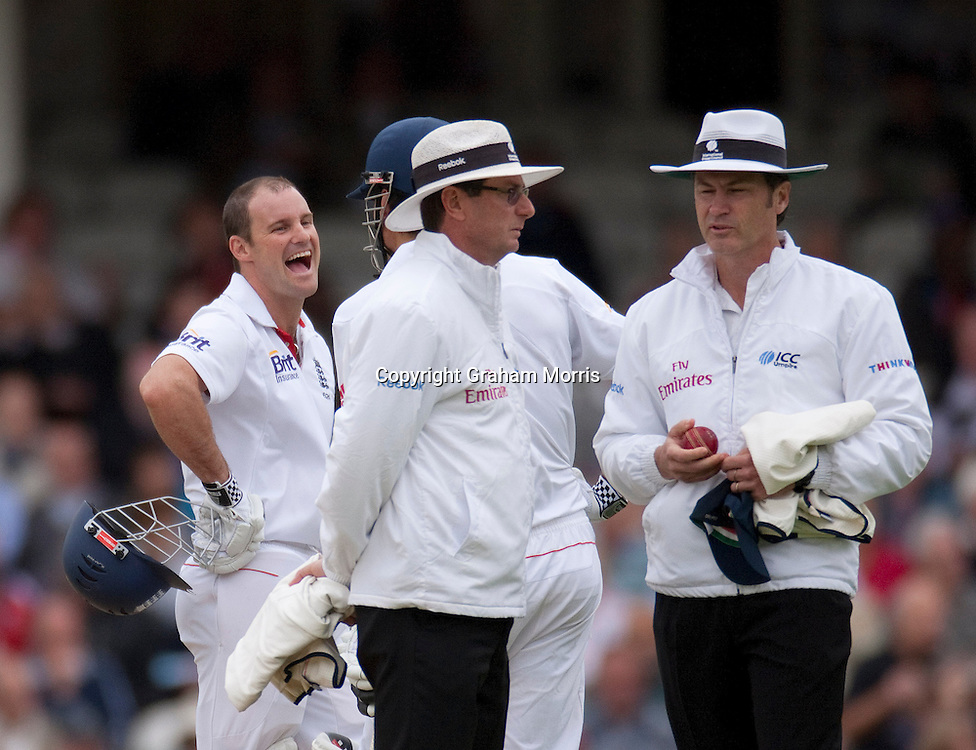 Andrew Strauss laughs after being hit on the helmet (breaking part of the peak off) by a ball from Ishant Sharma during the fourth and final npower Test Match between England and India at the Oval, London.  Photo: Graham Morris (Tel: +44(0)20 8969 4192 Email: sales@cricketpix.com) 18/08/11