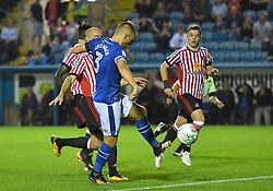 Carlisle United's Danny Grainger scores his team's first goal as he taps in the rebound from his missed penalty