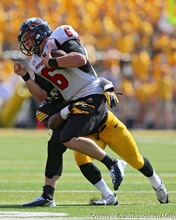 August 31 2013: Northern Illinois Huskies quarterback Jordan Lynch (6) is hit by Iowa Hawkeyes defensive back Jordan Lomax (27) during the first quarter of the NCAA football game between the Northern Illinois Huskies and the Iowa Hawkeyes at Kinnick Stadium in Iowa City, Iowa on August 31, 2013. Northern Illinois defeated Iowa 30-27.