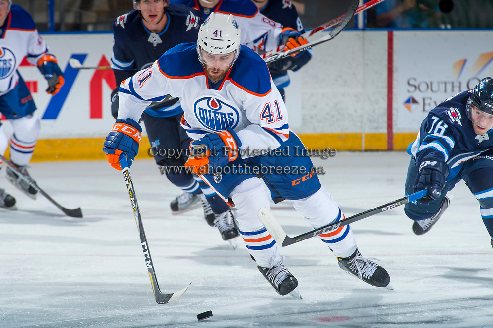 PENTICTON, CANADA - SEPTEMBER 9: Evan Polei #41 of Edmonton Oilers skates with the puck against the Winnipeg Jets on September 9, 2017 at the South Okanagan Event Centre in Penticton, British Columbia, Canada.  (Photo by Marissa Baecker/Shoot the Breeze)  *** Local Caption ***
