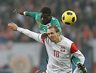 POZNAN 17/11/2010.FOOTBALL INTERNATIONAL FRIENDLY.POLAND v IVORY COAST.Adrian Mierzejewski of Poland and Emmanuel Eboue of Ivory Coast ..Fot: Piotr Hawalej / WROFOTO