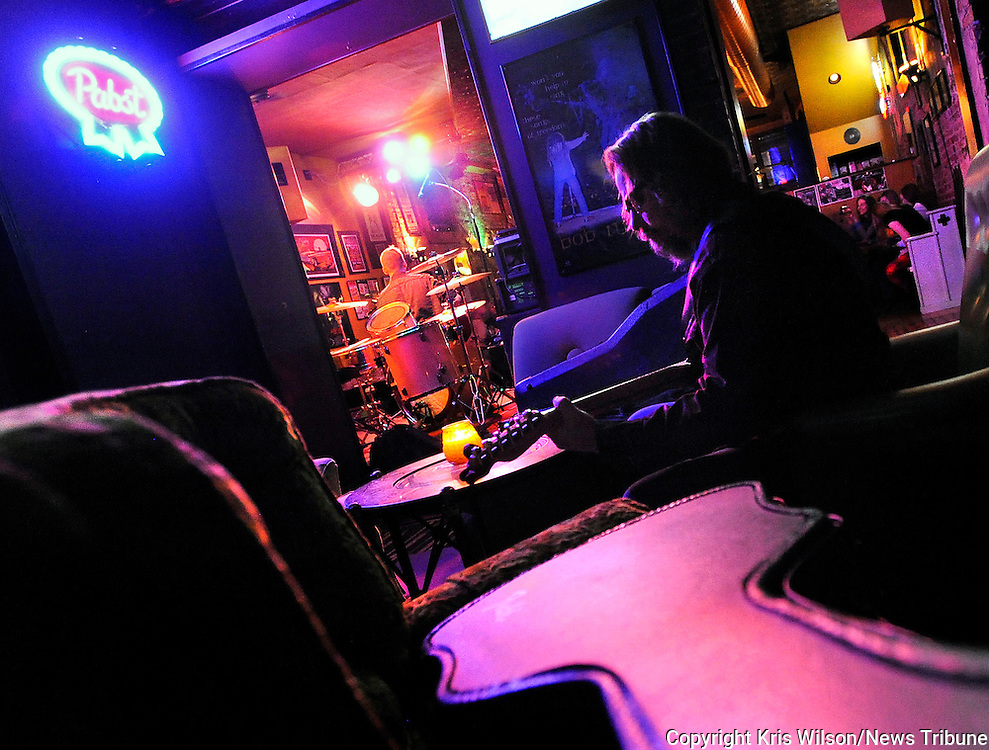 Kris Wilson/News Tribune<br /> Jefferson City musician John Botts warms up backstage while waiting to follow up Cody Amos's set in the front of the house during an open mic night at The Mission.