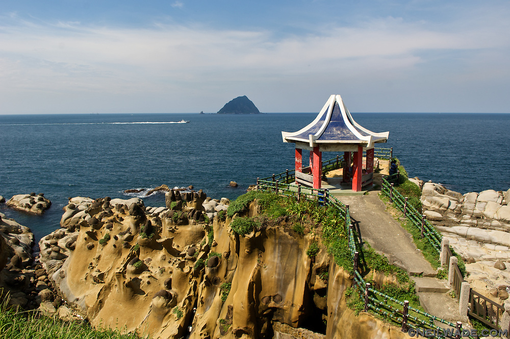 Tourists relax in a Chinese Pagota in Keelung, Taiwan's Hoping Coastal Park.