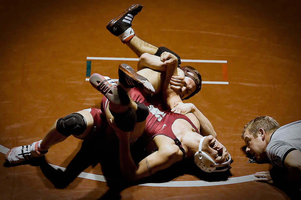 JEROME A. POLLOS/Press..Northwest College's Eddie Whiting struggles to overpower Adam Tinnel, from North Idaho College, as Ryan Wood gets into position to call for the pin Tinnel secured during the 125-pound match Friday.