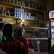 Liberians in a downtown shop watch the  televised verdict announcement of accused war criminal and former president of Liberia Charles Taylor. Monrovia, Liberia, April 2012.