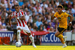 Tom Ince of Stoke City goes past Morgan Gibbs of Wolverhampton Wanderers - Mandatory by-line: Robbie Stephenson/JMP - 25/07/2018 - FOOTBALL - Bet365 Stadium - Stoke-on-Trent, England - Stoke City v Wolverhampton Wanderers - Pre-season friendly