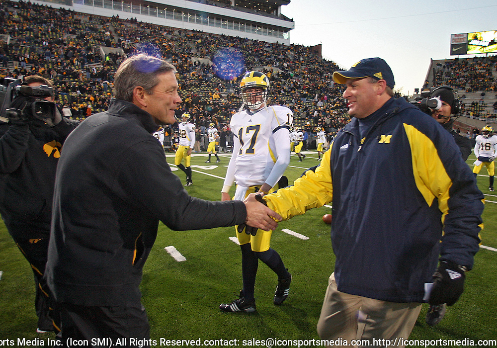 October 10, 2009: Iowa head coach Kirk Ferentz and Michigan head coach Rich Rodriguez shake hands before the Iowa Hawkeyes' 30-28 win over the Michigan Wolverine's at Kinnick Stadium in Iowa City, Iowa on October 10, 2009.