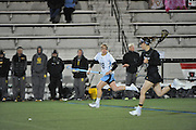 In a battle that was close until the last 10 minutes, Johns Hopkins downed the Towson Tigers women's lacrosse team 12-8 Wednesday night at Homewood Field in Baltimore.In a battle that was close until the last 10 minutes, Johns Hopkins downed the Towson Tigers women's lacrosse team 12-8 Wednesday night at Homewood Field in Baltimore.