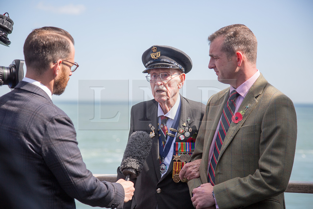 @Licensed to London News Pictures 21/05/15. Dover, Kent.94 year old Warrant Officer Arthur Taylor RAF (centre) commemorates the 75th anniversary of Operation Dynamo today aboard DFDS Ferries crossing to Dunkirk in France. Operation Dynamo was the name given to the planned evacuation of Allied troops from the beaches of Dunkirk in 1940 during WWII.Photo credit: Manu Palomeque/LNP