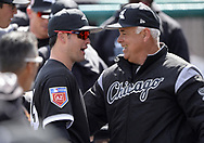 GLENDALE, ARIZONA - FEBRUARY 28:  Eddy Alvarez and Manager Rick Renteria #17 of the Chicago White Sox talk prior to the game against the Texas Rangers on February 28, 2018 at Camelback Ranch in Glendale Arizona.  (Photo by Ron Vesely)  Subject:   Ricky Renteria; Eddy Alvarez