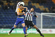Jim McNulty heads clear from Jimmy Spencer and Joe Rafferty during the EFL Cup match between Mansfield Town and Rochdale at the One Call Stadium, Mansfield, England on 8 August 2017. Photo by Daniel Youngs.